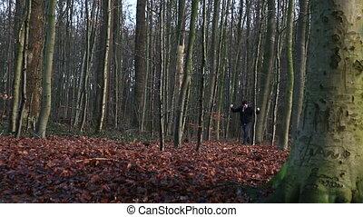 Walking man throwing hands in air