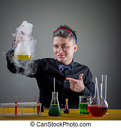 magician in chemical laboratory prepares magical solution