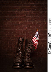 Boots with Flag - A pair of combat boots with a small...
