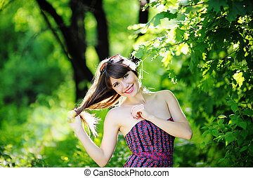 beautiful woman with long hair in summer park