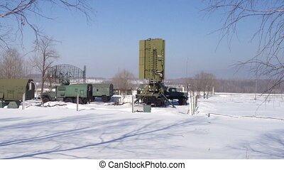 Green military radar station rotates in winter
