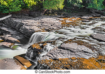 Manido Falls - Presque Isle River whitewater flows over...