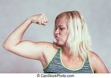 Strong muscular sporty woman flexing biceps - Strong...