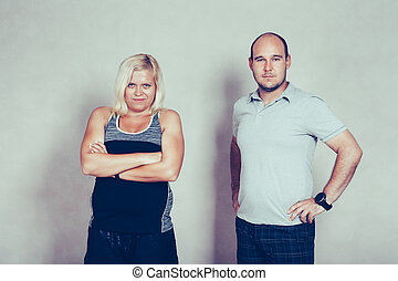 Confident sporty corpulent couple