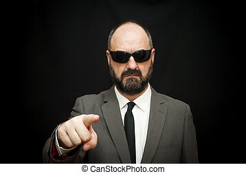 Handsome business man, bald and beard, with sunglasses who...