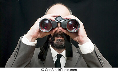 Handsome business man, bald and beard, looking through...