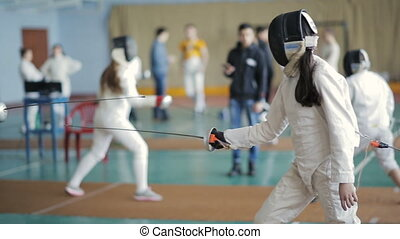 fencers women on a training - Two man fencers on competition