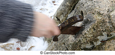 knight tries to remove Excalibur sword in the stone -...