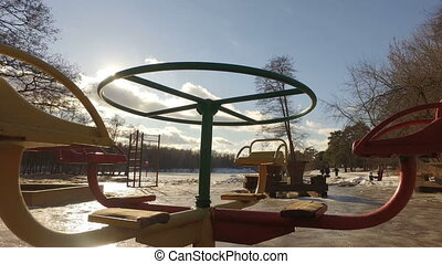 Slowly spinning roundabout with no kids on it. retro swing...