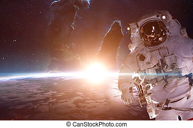 Astronaut in space over the planet Earth Elements of this...