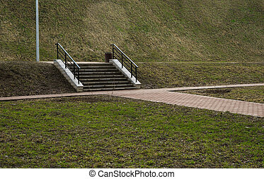 stairs in the park on green background