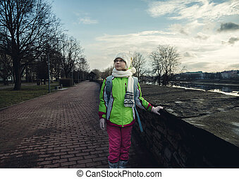 girl child standing in spring Park on sky background - girl...