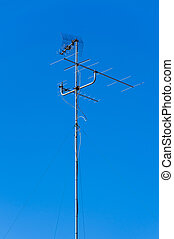Television analogic antenna in a blue sky background