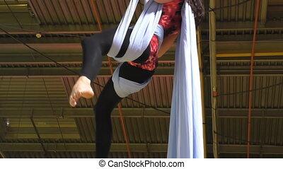 Aerial silk performer - Girl performing on aerial silks or...