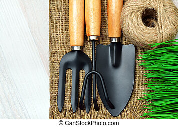 gardening tools, green grass on sacking