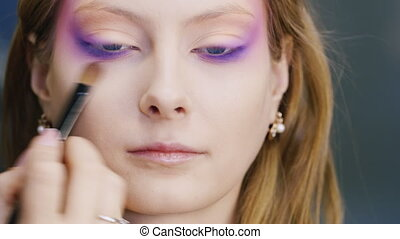 Beautiful young woman applied make-up