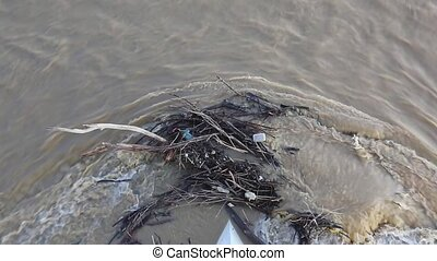 Debris in River - Water and Debris at Bridge in Sava River...