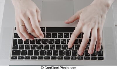 Businesswoman hands working on laptop computer at home...