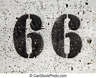 Sixty-six - Number 66 painted on a concrete surface