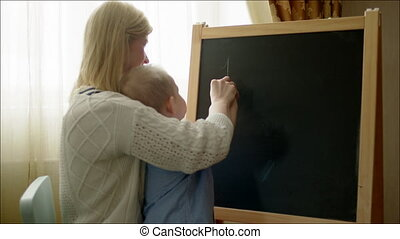 Mother Teaching Son Numbers