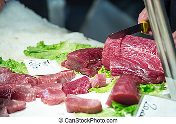 fisherman for bluefin tuna - fisherman cuts a slice of red...