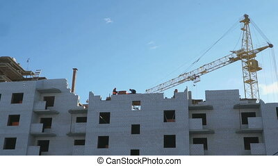 Construction of apartment houses Construction crane and...