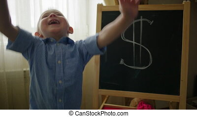 Little Boy under Money Rain - Little boy is jumping happily...