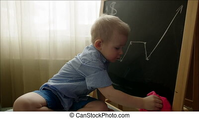 Boy Wiping off the Growth Graph from the Chalkboard - Little...