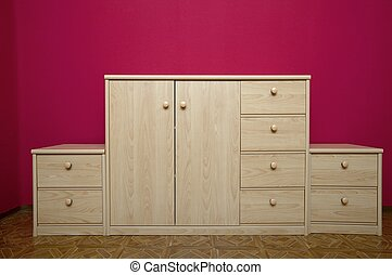 Cabinet with drawers in a room