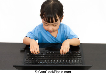 Chinese little girl using laptop in plain isolated white...