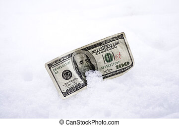 Cold Cash - One hundred dollar bill laying in the snow