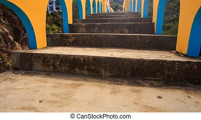 Camera Moves along Blue Yellow Bridge to Pagoda in Vietnam -...