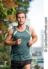 Training - man running in park