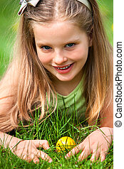 Child find easter egg outdoor - Portrait of kid find easter...