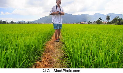 Old Man Photos Landscape among Rice Field against Mountains...