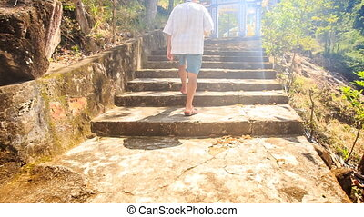 Backside Old Man Climbs Stone Steps to Pagoda Gate in...