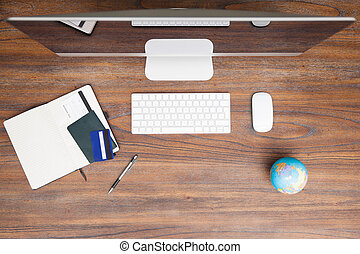 Workspace of a travel agent - Top view of a wooden desk with...