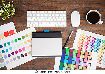 Office desk of a graphic designer - Top view of the...