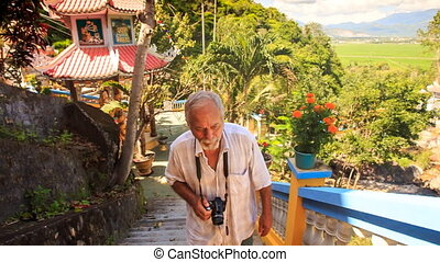 Old Man Climbs Steps by Pagoda Barrier Photos in Vietnam -...