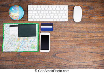 World traveler's desk from above - Top view of a desk of a...