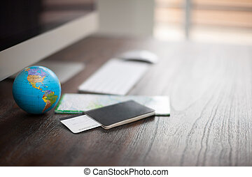 Workspace of a world traveler - Closeup of the desk of a...