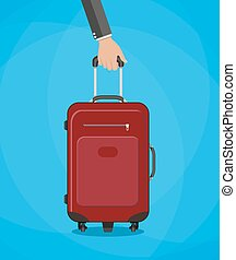 red travel bag with hand - Hand holding red travel bag....
