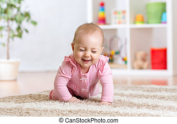 cheerful funny baby crawling indoors at home