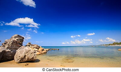 Transparent Waves Wash Rocks on Sand Beach Clouds Motion -...