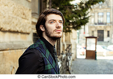 elegant man in plaid on the street - clouse up of an elegant...