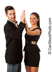 Business couple celebrating success, clapping with hands...