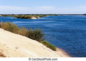 bank of the river zambezi - bank of the Zambezi river -...