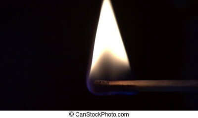 Burning match in slow motion - Close up of burning match in...