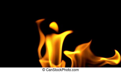 Fire flames in slow motion on black background