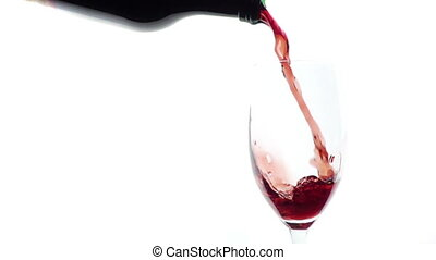 Pouring red wine into glass .